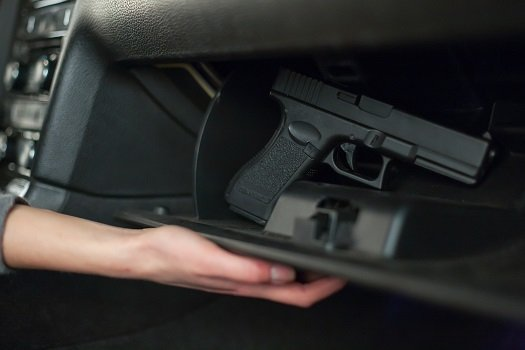 When purchasing a gun, there are many facts you need to know about the firearm as well as laws and regulations pertaining to ownership. Failing to learn as much as possible could lead to severe consequences. Many people have different questions, such as if they can carry their guns and keep them stored in their cars' glove compartments. Continue reading to learn more about storing your weapon in a glove box and related issues. Gun Safety Carrying a gun in certain states is permitted for individuals who meet legal requirements, such as being of age, having no felony convictions, and completing permit applications. Other regulations, such as those governing storage, include keeping the firearm in the glove compartment. Storing the handgun in the glove box can keep you and your family safe while you're in the car or if your children are inside the garage or near your vehicle while you're away. Keep the glove box locked, and only provide access to your spouse or other family members who are legally allowed to operate or carry a firearm. Alerting Authorities In many situations, law enforcement officers are the only authorities who must be alerted that a gun is in the vehicle if they stop you for a routine traffic violation or any other reason. Failing to inform the police that a gun is in the glove compartment could cause them to become suspicious if a search is conducted and the handgun is found. Therefore, it would be best to tell the officer you have a legal permit to carry the gun and let him or her know where the weapon is stored. Plain View Although legal gun owners in some states can carry their firearms in public, including in their vehicles, this doesn't give them the authority to have their guns in plain view, meaning they cannot have firearms out inside the car. People outside the vehicle shouldn't be able to see your gun unless they're authorities and have asked you to place the firearm on the seat or another location in plain view. Out-of-sight locations whe